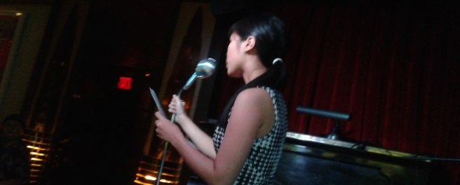 me reading for the Village Voice at KGB Bar '15 - cover photo